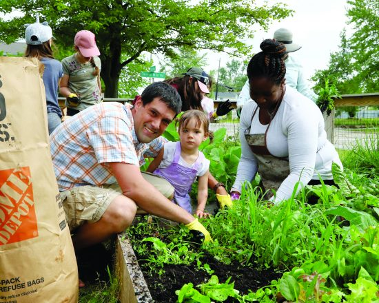 Chad and Miriam Techner of West Bloomfield tend to the Henrietta and Herbert Charfoos Kadima Center Community Garden in Southfield with Molisia Young, Kadima Zussman Activity Center coordinator.