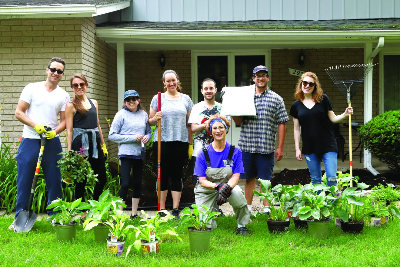 Federation NEXTGen volunteers help at a Kadima home: Ben and Erin Kramer, Birmingham; Lauren Cohn and Jaime Bean, both of Huntington Woods; Jason Rubenfire, West Bloomfield; Noah Betman, Detroit; Allison Huber of Kadima; and Janet Schenk, Bloomfield Hills. NEXTGen was a partner in the event. Gardening Day