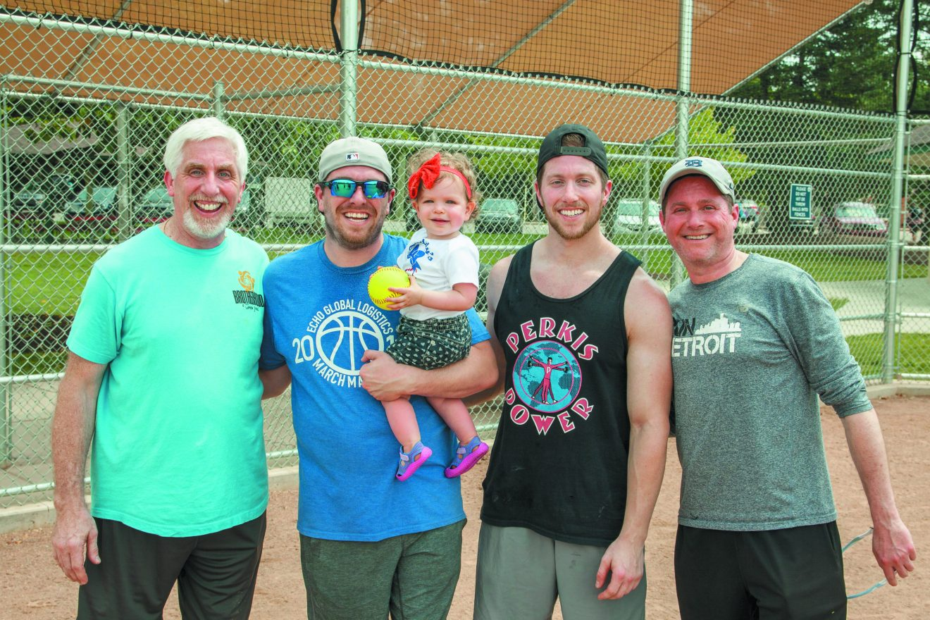 Teammates Steve Achtman (left), Brandon Achtman, Shawn Achtman and Jonathan Fellows and Brandon Achtman's daughter Ellianna Achtman. Photos by Chuck Freedman