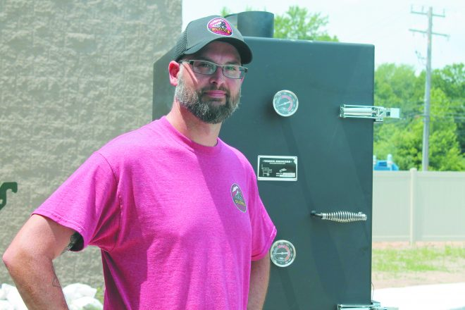 Slows Bar-B-Q Chef Michael Metevia mans the new smoker in the Farber Hebrew Day School parking lot.