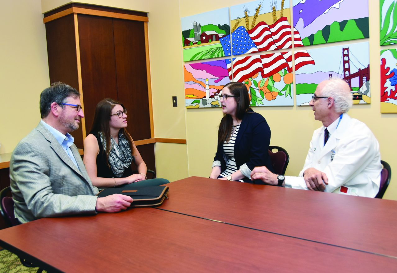 Howard and Sarah Katz, left, meet with Certified Genetics Counselor Rachel Hagen, MS, CGC and Michael Simon, M.D., MPH, medical director of the Cancer Genetic Counseling Service, both of the Barbara Ann Karmanos Cancer Institute.