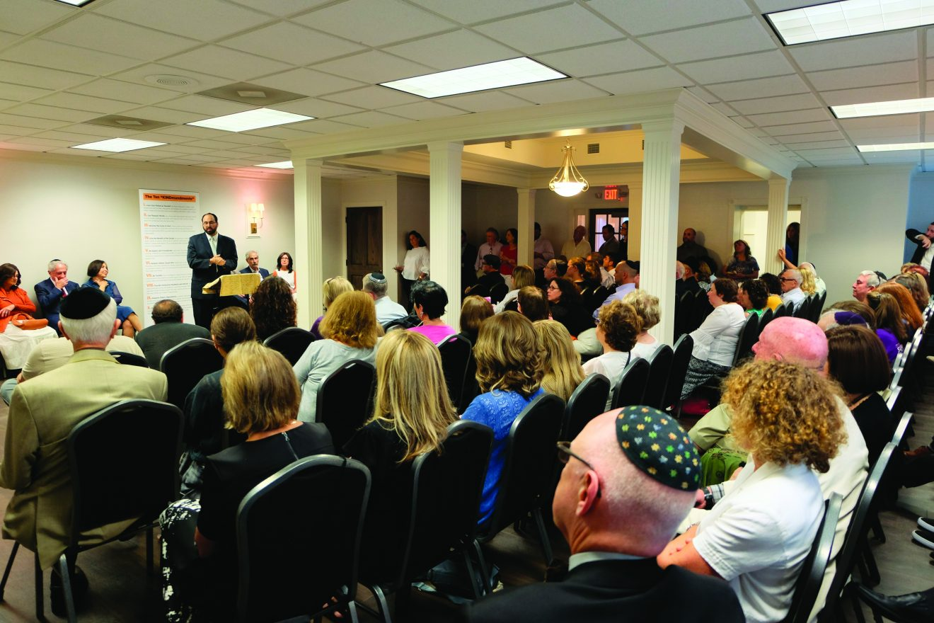 An overflow crowd listen to Rabbi Muller speak at the June 28 dedication ceremony of the Blumenstein Jewish Learning Center. /Credit: Dena Borsand