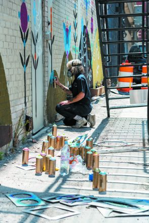 Muralist Bunnie Reiss at work
