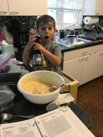 C squeezes the salt into the banana bread batter.