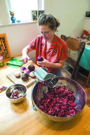Hannah Lewis prepares beets and turnips for fermentation.