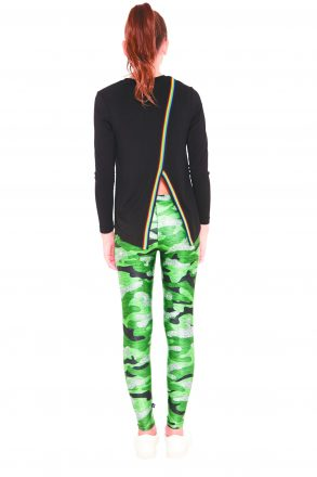Terez GLITTER CAMO LEGGINGS ($48) and RAINBOW TAPE SWEATER ($49). Guys N Gals, West Bloomfield. (248) 851-1260.