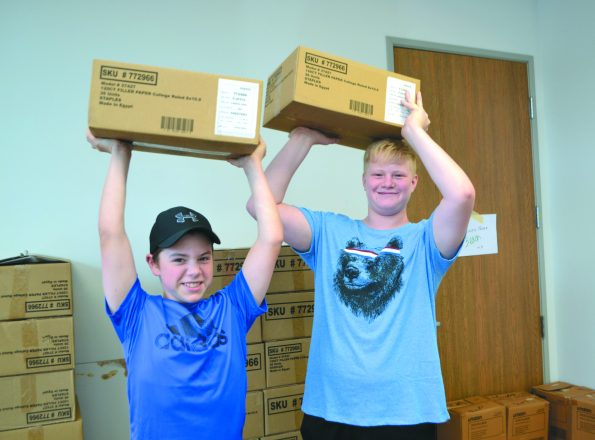Jake Berg and Josh Miller, both of Farmington Hills at the NCJW annual event to stuff backpacks.