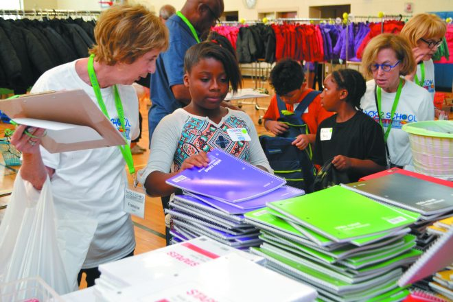 Volunteer Francine Snyder and student Ahlierah Howell. She was among 600 Detroit children who shopped for winter coats, clothing, shoes, personal items, school supplies, backpacks and books at the annual NCJW/MI Back 2 School store Aug. 12 at Munger Elementary-Middle School in Detroit.