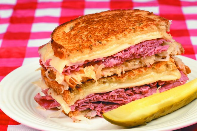 Corned Beef Reuben Sandwich - Fresh corned beef on grilled Rye with melted Swiss and sauerkraut
