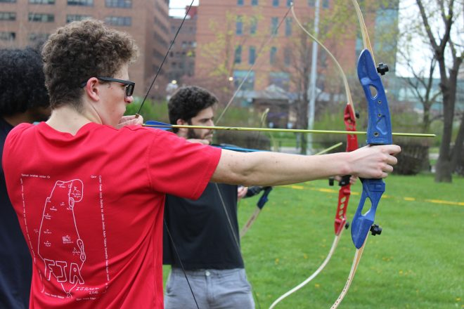 Students take aim at Hillel of Metro Detroit/ChabaD of Great Downtown Detroit's Lag b'Omer Bonfire & Bows event.