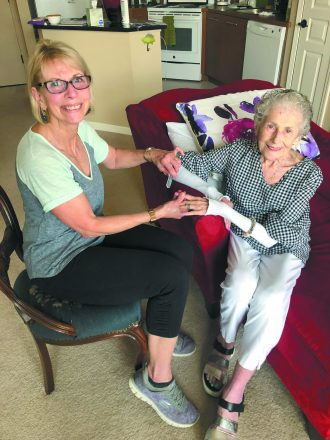 Lauretta Figg receives an in-home manicure from JHCN salon specialist Laurie Novetsk.
