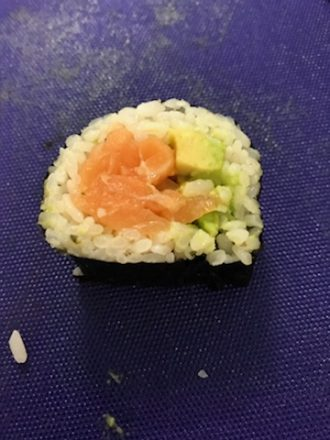 A salmon and avocado sushi roll.