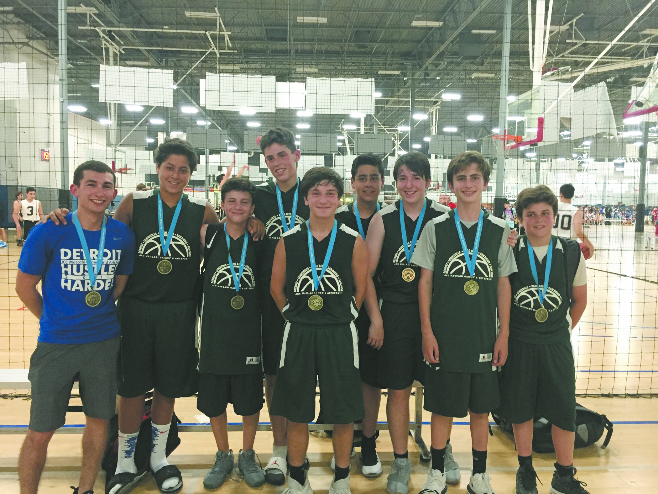 From left, Coach Jeremy Fishman and players Noah Kam, Alex Mayoras and Carson Brodsky on the gold medal-winning 14U boys basketball team.