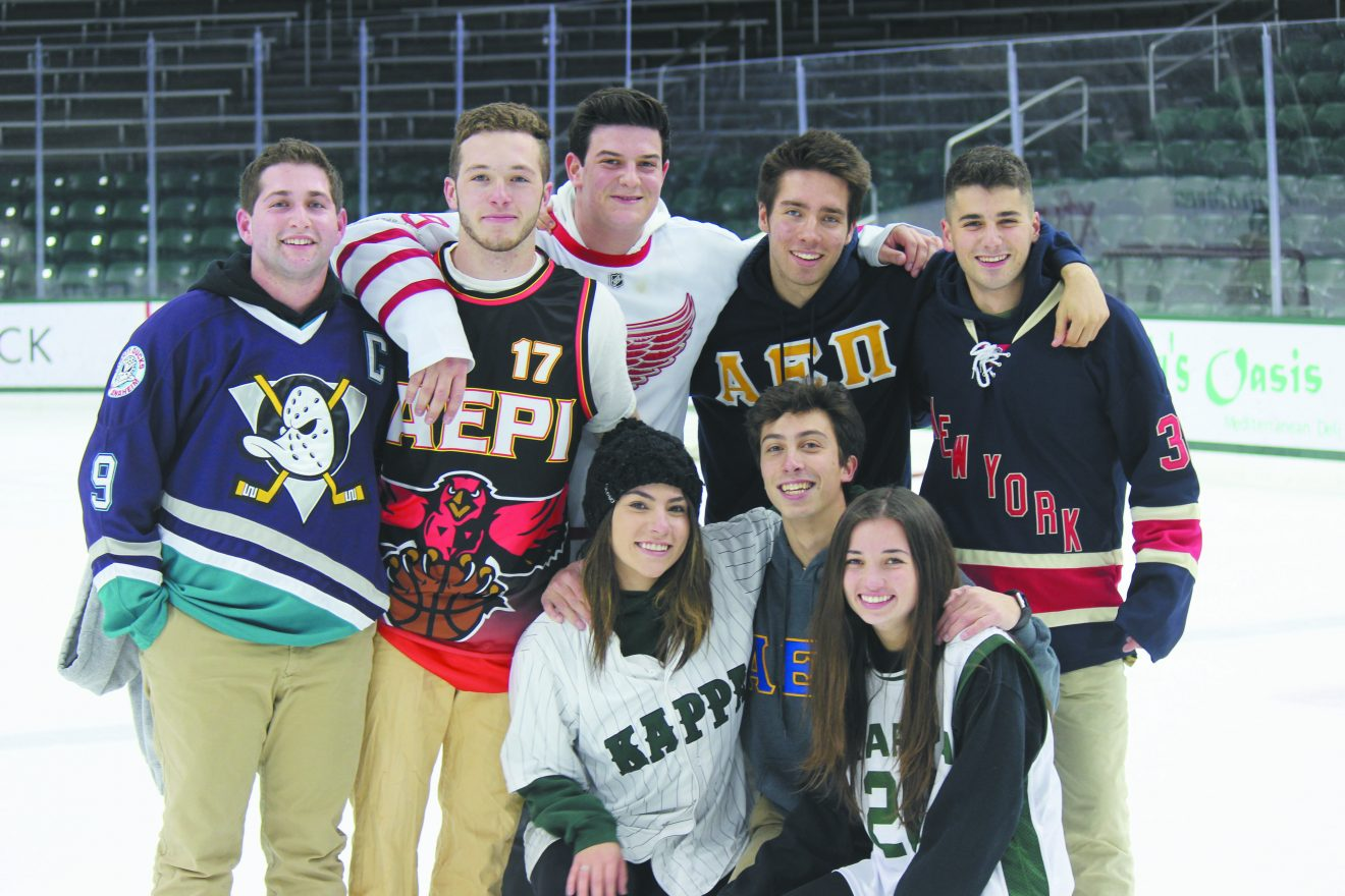 MSU students enjoying a fun night of competition at the Ryan Rosman Memorial Student Broomball Tournament: (top) Jordan Hankin; San Diego, Calif.; Hunter Moore, Scarsdale, N.Y.; Max Labe, Huntington Woods; Miles Moon, Birmingham; and Eric Wertheim, Suffern, N.Y.; (bottom) Lynn Hanna, Chicago; Max Vinocur, New York City; and Delaney Backonen, West Bloomfield.