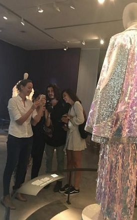 Yael Vizel, left, testing out the Zeekit app with clothing in the Decoding Israeli Dress exhibition, on July 31, 2018 (Ariella Gentin)