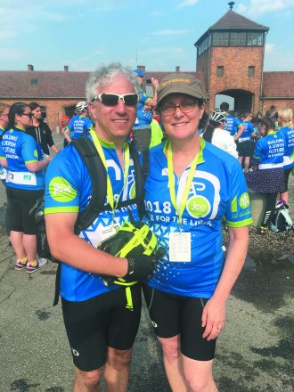 Arnie and Cheryl Berlin at Auschwitz-Birkenau at the beginning of the ride. Ride for the Living RFTL