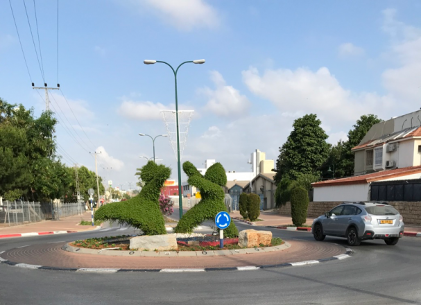 5:30 a.m. Kiryat Eqron traffic circle art. Not much traffic at this time of the morning. Fred and Ginger.