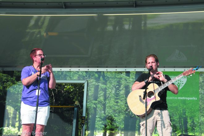 Jewish rocker musician Rick Recht sings with the JCC's Lisa Soble Siegmann at the Rick Recht Party and Outdoor Concert June 20 at the JCC in West Bloomfield.