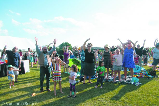 Concert-goers have fun getting into the music at the Rick Recht concert.