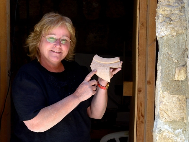 Photo by Oria Tadmor, courtesy of Eilat Mazar Archaeologist Eilat Mazar holds a jar fragment from the 10th century B.C.E. with a Canaanite inscription.
