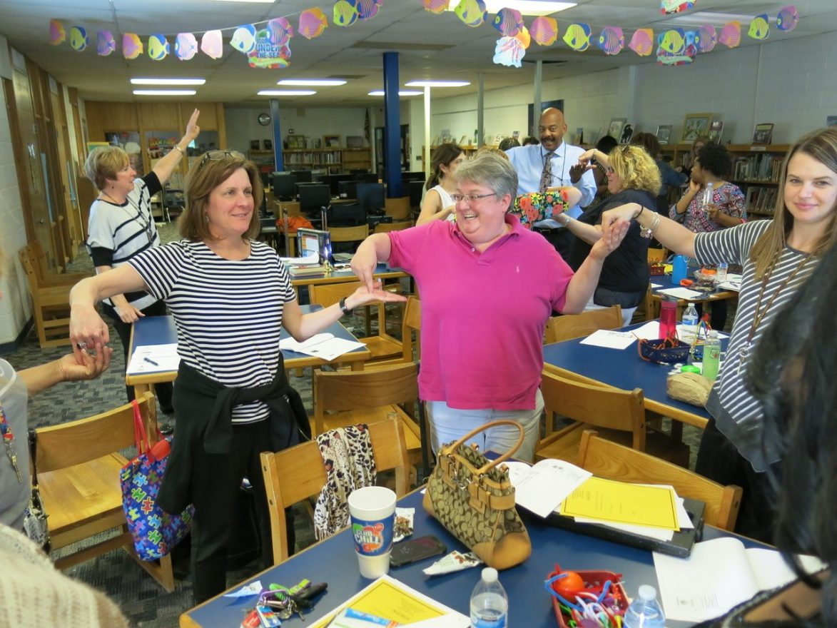 Staff at Pepper Elementary in Oak Park participate in a brain break 'Got Ya.""
