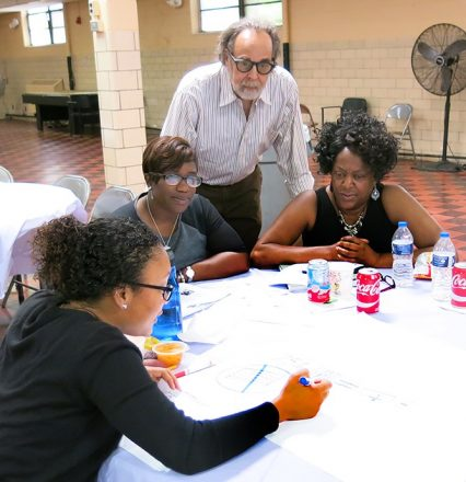 Staff at Detroit Youth Development Alliance in Detroit work on drawing their nonverbal responses.