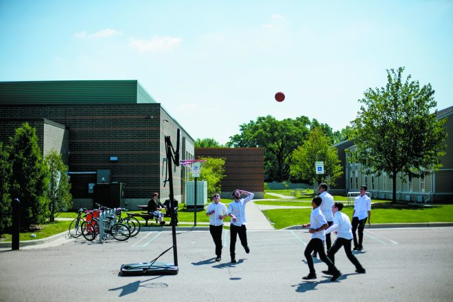 In the parking lot between the main building and their dorms, Friday Boys engage in a pick-up basketball game in the parking lot.