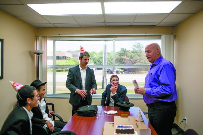 Levi and Moshe join another pair of Friday Boys to celebrate the Jewish birthday of CPA Jay Kalisky in his office on Orchard Lake Road in Farmington Hills.