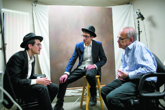 When it comes to discussing the week's Torah portion, Levi, the more talkative of the pair, usually delivers the interpretation that includes food for thought and action; Moshe needs a little more prodding to add his take, which brings another layer to the interpretation. During visits, the teens also chat, joke and banter to get to know the people they visit — and they let them know more about their lifestyle, too, which, unlike most teens, keeps them off TV and the internet. This give-and-take allows the boys and their regulars glimpses into each others' very different ways of life. Here, they are in the studio of Murray Goldenberg in Southfield.