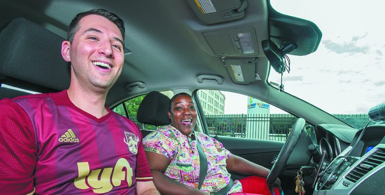 Elliot Darvick, Lyft general manager for Michigan and Ohio, shares the front seat with Lyft driver Mellisa Nelson of Detroit.