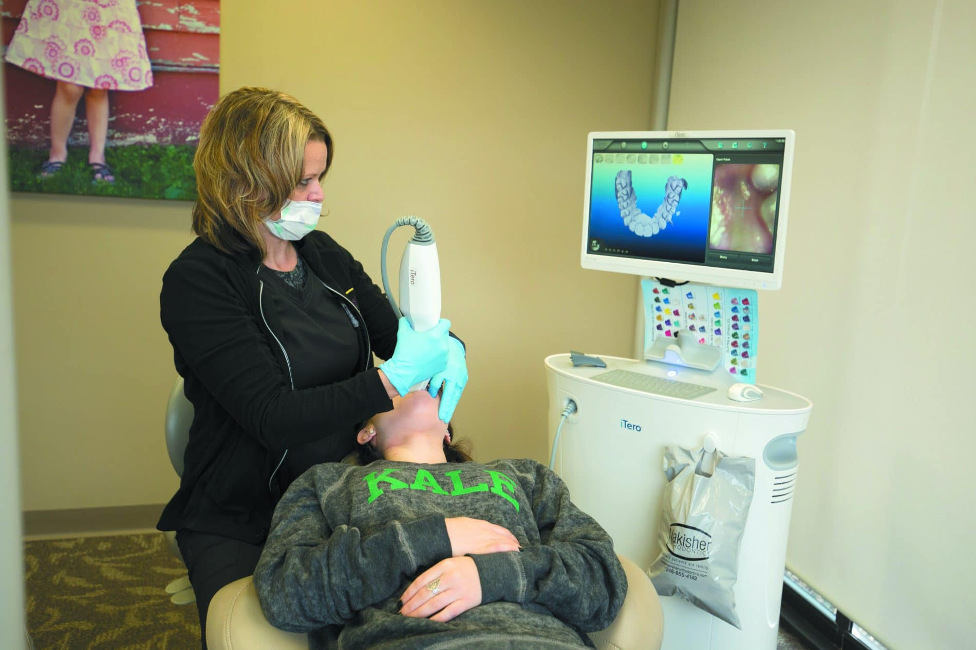 Dr. Andrea Nakisher uses an iTero scanner that is moved over the teeth to take fast, accurate digital impressions for Invisalign braces.