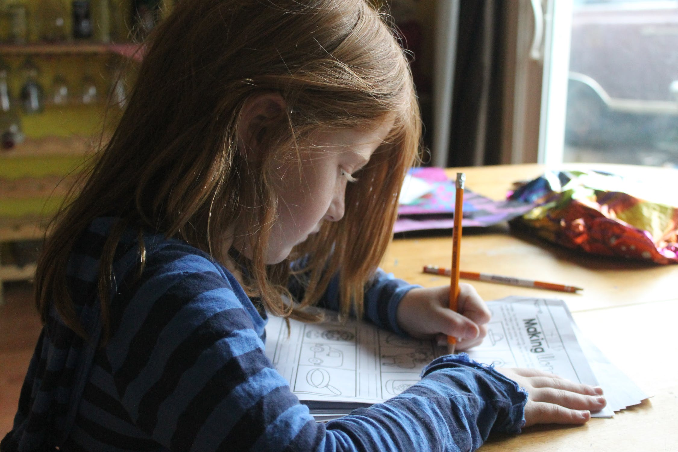 a little girl doing homework