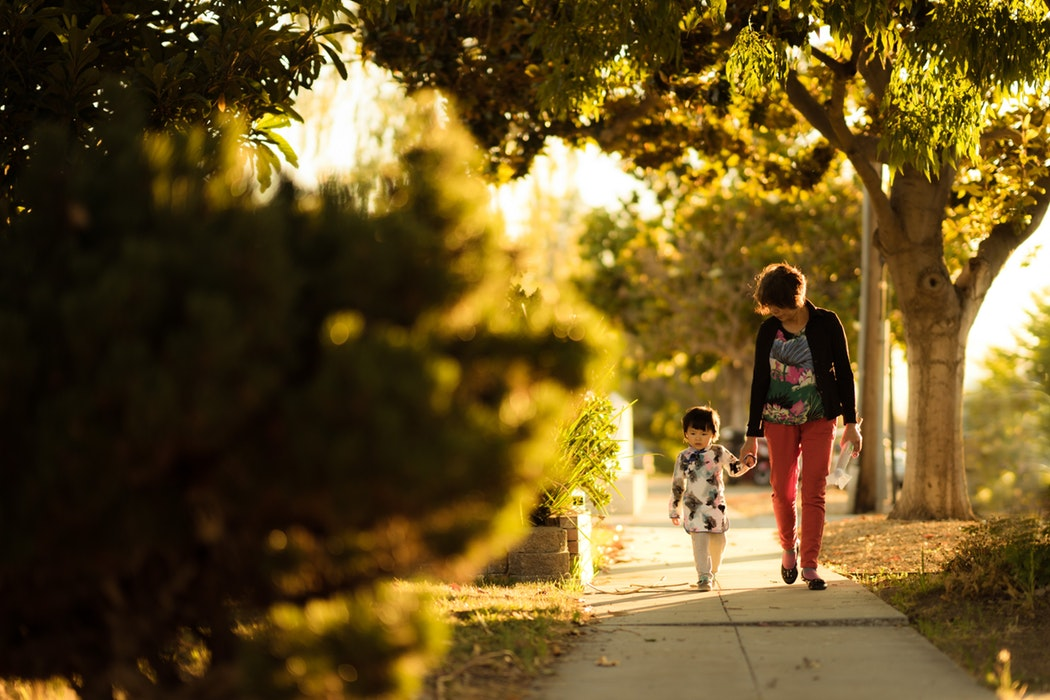 mom and child walking to show working mom back-to-school tips