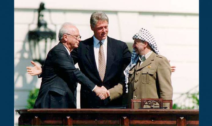 The historic handshake between Yasser Arafat and Yitzhak Rabin on the Declaration of Principles