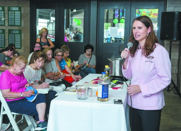 Cooking demonstrator and cookbook author Paula Shoyer of Chevy Chase, Md., shows the group how to make Tzimmis Puree.