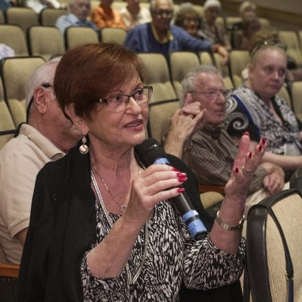 Renee Gerger of Novi directs a question to Robin Axelrod of the HMC.