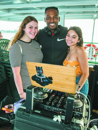 Julie Goldberg of West Bloomfield, DJ Dennis Lee and Zeisa Ribiat of Detroit