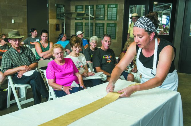 Baker Sara Molinaro of Zingerman's Bakehouse shows the gathered how to make flaky strudel dough.