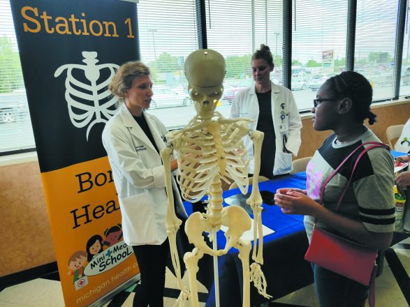 Volunteers teach about bone health in Flint.