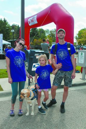 Kristin Hipwell, Jeremy Harvey, their daughter, Julianna, and their service dog, Scrubs