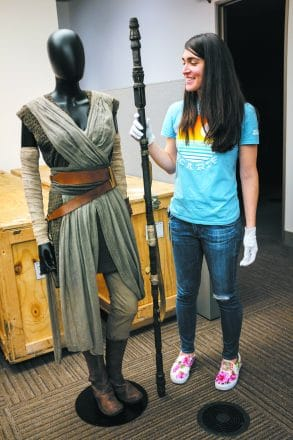 The staff and costume worn by the character Rey in Star Wars:The Force Awakens. PHOTO VIA STARWARS.COM © 2018 & TM LUCASFILM LTD. KYLE KAO AND AMANDA JEAN CAMARILLO