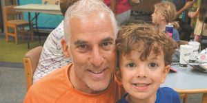 Rabbi Josh Bennett of Temple Israel with Solomon Kaplan, 6, at the Special Person event at Lone Pine Elementary School