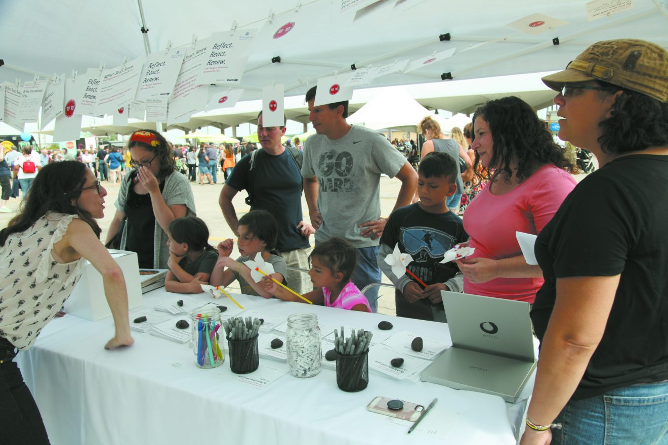 Reboot Creative Director Francine Hermelin Levite speaks with people at Detroit's Jewish Food Festival.