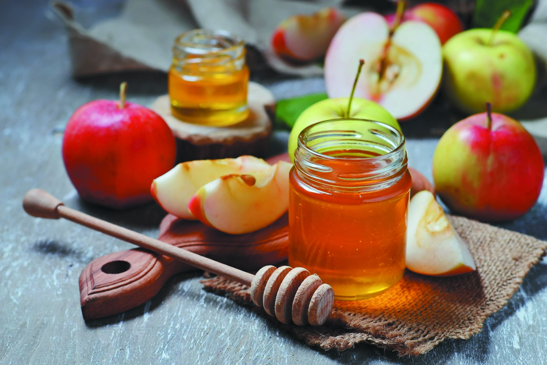 Honey with apple for Rosh Hashana, jewish New Year. Selective focus. community