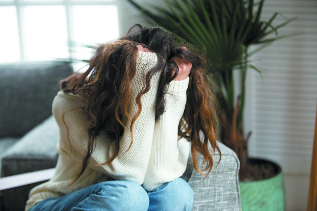 Young woman victim suffering from abuse, harassment, depression or heartbreak, sad desperate teenager having problems holding head in hands, heartbroken upset girl crying having dangerous addiction. Anxiety.