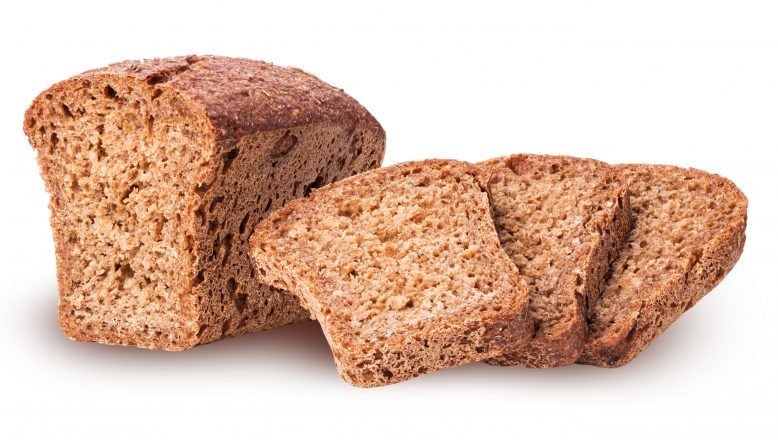 Healthy bread from sprouted grain cut in half and slice isolated on white background. Clipping Path. Full depth of field.