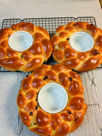 Marc Sussman makes these round, braided raisin challahs and puts ramekins in the middle for honey for Rosh Hashanah.