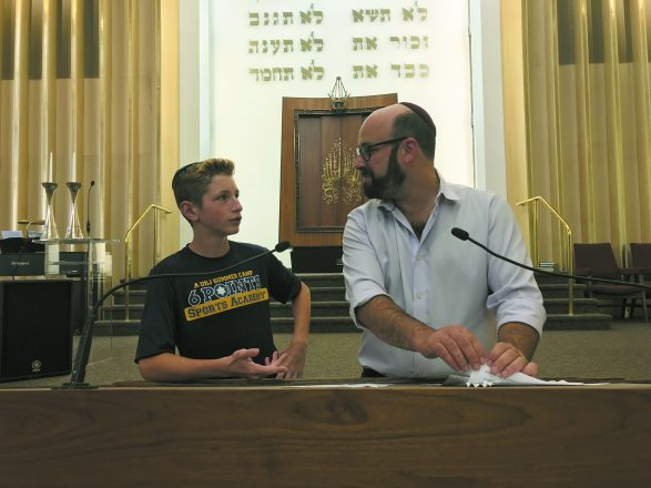 Ben Taylor-Abt rehearses for his bar mitzvah with Rabbi Matthew Zerwekh.