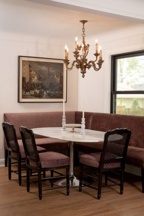 The corner banquette dining table can seat 10 people.