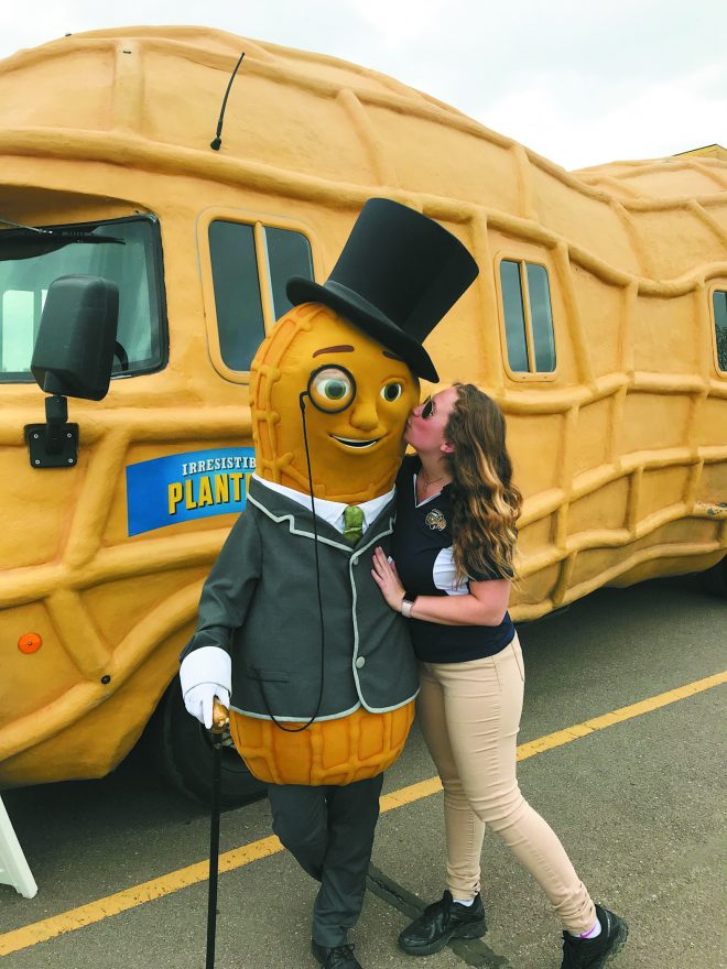 Jaclyn Nagel plants a kiss on Mr. Peanut.